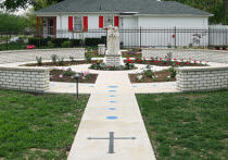 The new rosary garden at Holy Family Parish in Danville is in the shape of a monstrance when viewed from above. It features a statue of the Holy Family in the center and the beads of the rosary on the walkway. (For the Catholic Post/Deb Edwards)